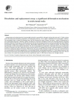 Dissolution and replacement creep: a significant deformation mechanism in mid-crustal rocks